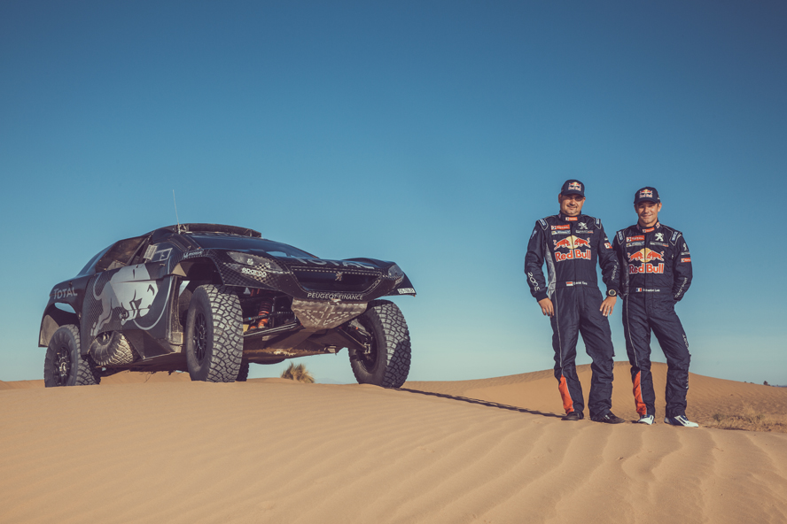 Sebastien Loeb and Daniel Elena pose for a portrait during the Peugeot test in Erfoud, Morocco on September 16, 2015
